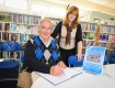 Community librarian Elena Parkin with Mr Bell signing the memory book.