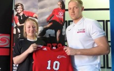 Dayna Kingshott with her Owens Junior College shirt and CWA Girls' Elite Football Programme head coach, Jamie Buhlemann.