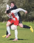 Stoke Ferry's Andrew Carter holds off a challenge