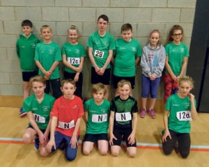 The Ryston Runners line-up at the Sportshall League match. Back, from left: Max Pike, Liam Clare, Bea Honeybone, Bailey Took, William Evans, Lily Teasdale,  Maisee Loram. Front: David MacQueen, Malakai Took, George Evans, Oakley Took and Matilda Loram.